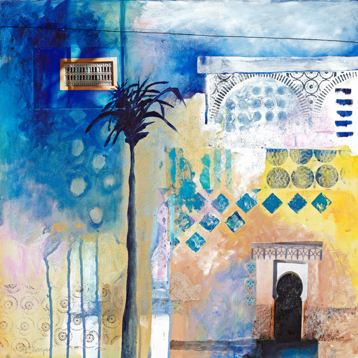 blue and yellow moroccan building and palm tree