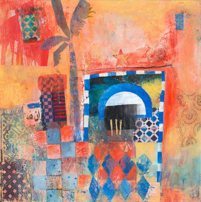 moroccan facade and doorway in oranges with decorative tiles and palm tree